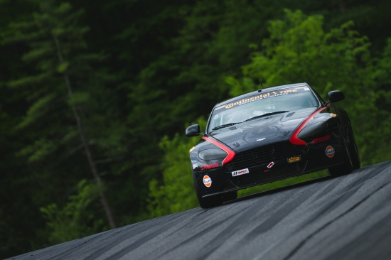 Getting light at the top of the famous Lime Rock jump. Requires a throttle lift to manage wheel spin.
